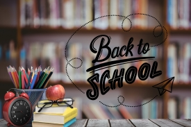 Digital composite of School materials and apple with back to school text and library background